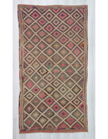 Handwoven vintage pink coloured embroidered Turkish kilim rug