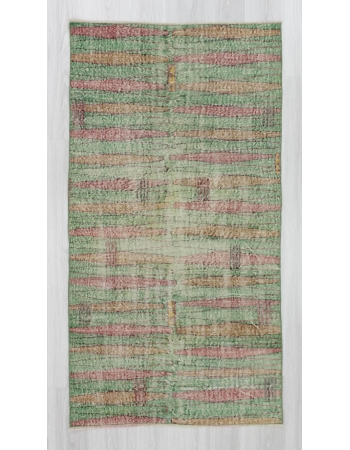 Distressed vintage green ground Turkish art deco rug