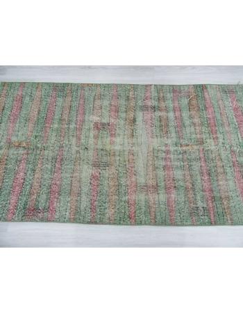 Distressed vintage green ground Turkish art deco rug