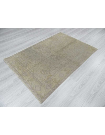 Distressed washed out Turkish rug