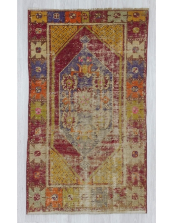 Vintage distressed colorful small Turkish rug