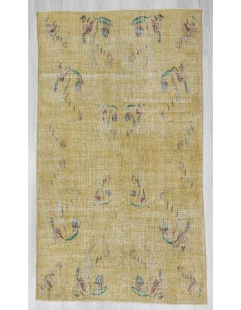 Distressed vintage yellow Turkish deco rug