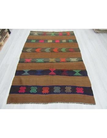 Embroidered vintage wool kilim rug