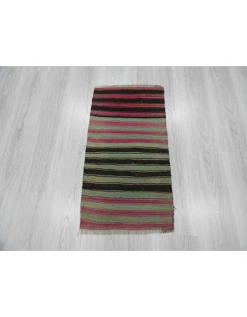 Purple,black,green striped mini kilim rug