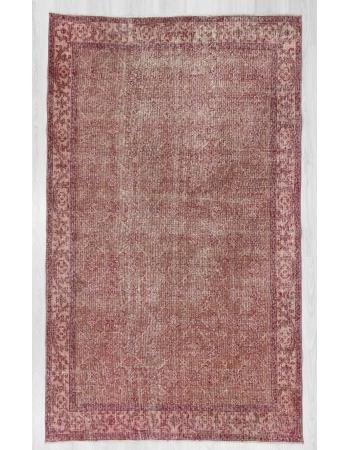 Distressed vintage Turkish rug