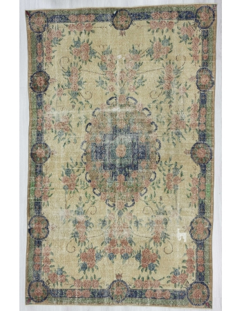 Distressed floral designed vintage Turkish rug