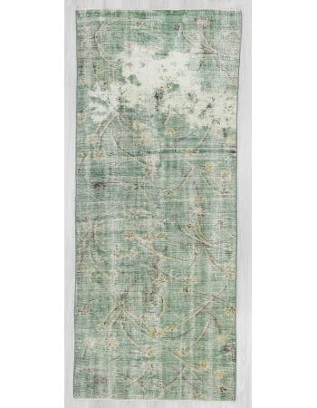 Distressed green Turkish deco rug