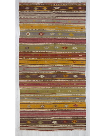 Embroidered colorful vintage kilim rug