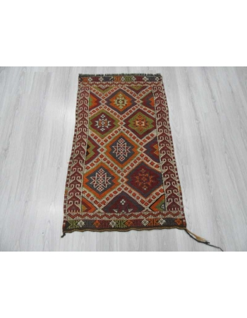 Small Vintage embroidered kilim rug