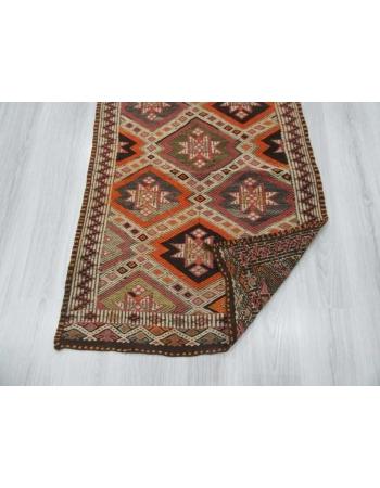 Embroidered small kilim rug