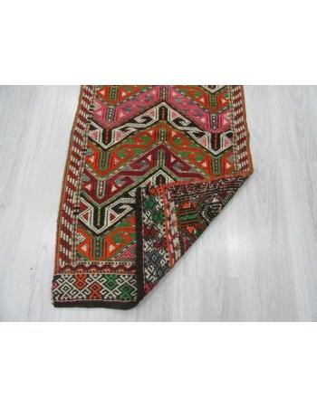 Vintage small embroidered kilim rug