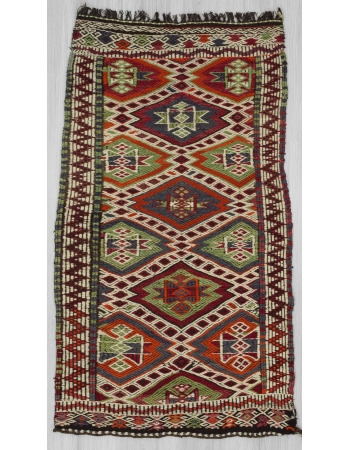 Embroidered vintage small kilim rug