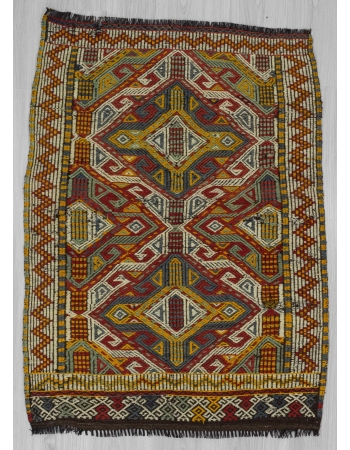 Small Vintage embroidered kilim rug