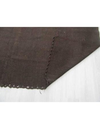 Dark brown vintage kilim rug