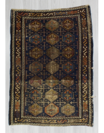 Distressed Antique Baluch Rug