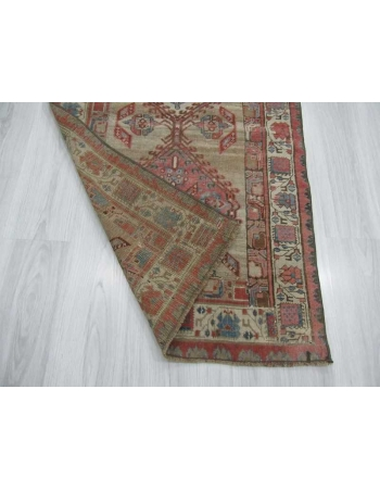 Antique distressed small Persian rug